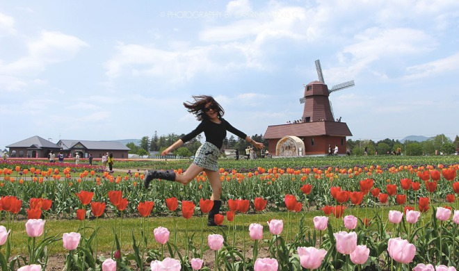 Running through the flower field Kamiyubetsu Tulip Park Japan Travel blog